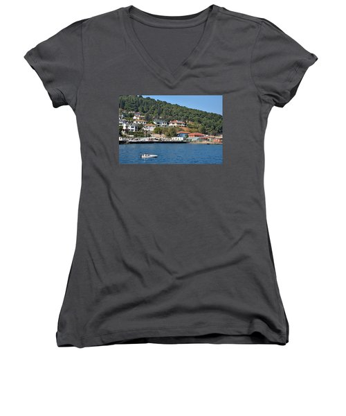 Women's V-Neck T-Shirt (Junior Cut) featuring the photograph Marina Bay Scene With Boat And Houses On Hills by Imran Ahmed