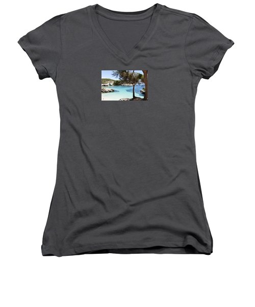 Paradise In Minorca Is Called Cala Mitjana Beach Where Sand Is Almost White And Sea Is A Deep Blue  Women's V-Neck T-Shirt (Junior Cut) by Pedro Cardona