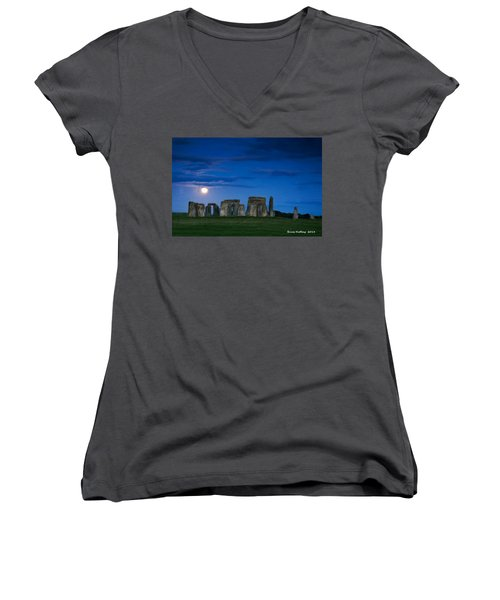 Women's V-Neck T-Shirt (Junior Cut) featuring the painting Stonehenge At Night by Bruce Nutting