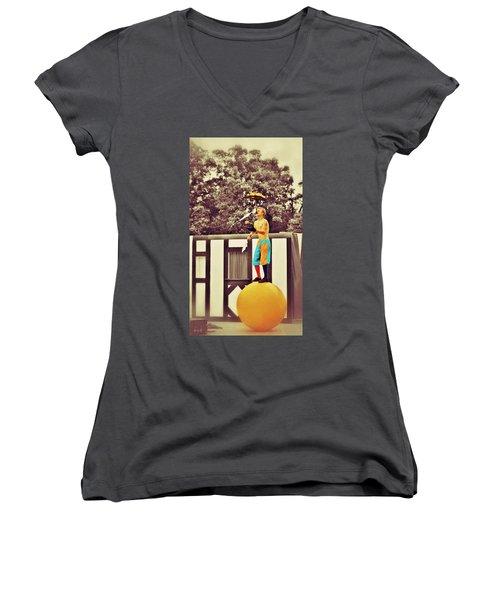 Women's V-Neck T-Shirt (Junior Cut) featuring the photograph The Juggler by Jean Goodwin Brooks
