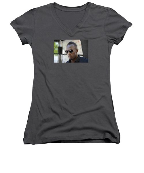 Women's V-Neck T-Shirt (Junior Cut) featuring the photograph Usain Bolt - The Legend 3 by Teo SITCHET-KANDA