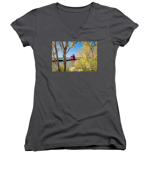 Women's V-Neck T-Shirt (Junior Cut) featuring the photograph Holland Mi Lighthouse by Larry Carr
