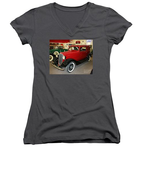 Women's V-Neck T-Shirt (Junior Cut) featuring the photograph 1930's Antique Chevrolet Sedan by John Black