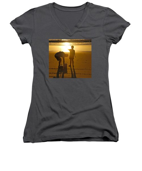 Women's V-Neck T-Shirt (Junior Cut) featuring the photograph Teach A Man To Fish... by Eric Tressler