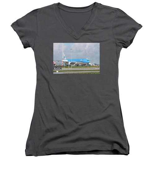 Women's V-Neck T-Shirt (Junior Cut) featuring the photograph Klm Airplane At Amsterdam Schiphol Airport by Hans Engbers