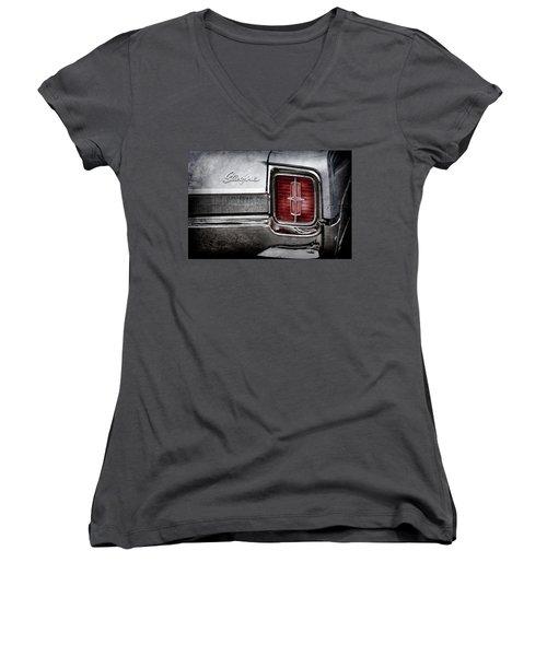 Women's V-Neck T-Shirt (Junior Cut) featuring the photograph 1965 Oldsmobile Starfire Taillight Emblem -0212ac by Jill Reger