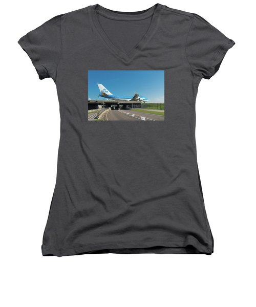 Airplane Over Highway Women's V-Neck T-Shirt (Junior Cut) by Hans Engbers