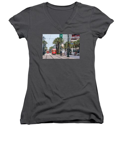 Women's V-Neck T-Shirt (Junior Cut) featuring the photograph New Orleans Canal Street Streetcars by Andy Crawford