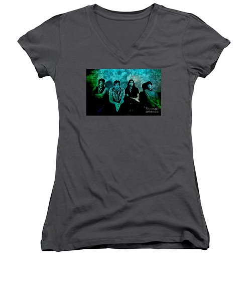 Women's V-Neck T-Shirt (Junior Cut) featuring the mixed media Kings Of Leon by Marvin Blaine