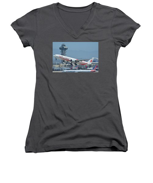Women's V-Neck T-Shirt (Junior Cut) featuring the photograph Air China Boeing 777-39ler B-2035 Smiling China Los Angeles International Airport May 3 2016 by Brian Lockett