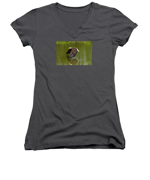 Bald Eagle In Low Flight Over A Lake Women's V-Neck T-Shirt (Junior Cut) by Les Palenik