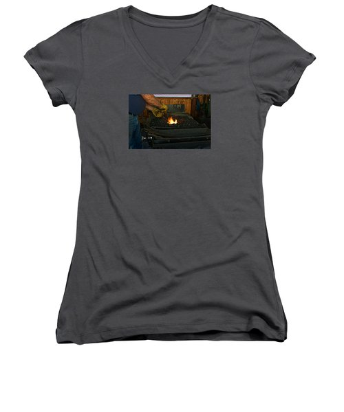 Women's V-Neck T-Shirt (Junior Cut) featuring the photograph Blacksmith At Work by Steven Clipperton