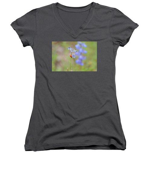 Women's V-Neck T-Shirt (Junior Cut) featuring the photograph Blue Bonnets And A Lady Bug by Carolina Liechtenstein
