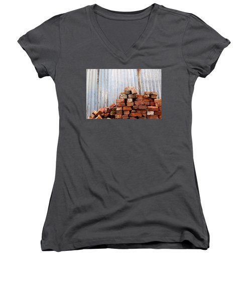 Women's V-Neck T-Shirt (Junior Cut) featuring the photograph Brick Piled by Stephen Mitchell