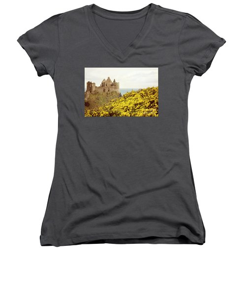 Women's V-Neck T-Shirt (Junior Cut) featuring the photograph Castle Ruins And Yellow Wildflowers Along The Irish Coast by Juli Scalzi