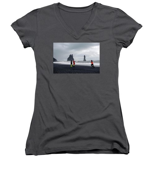 Women's V-Neck T-Shirt featuring the photograph China's Tourists In Reynisfjara Black Sand Beach, Iceland by Dubi Roman