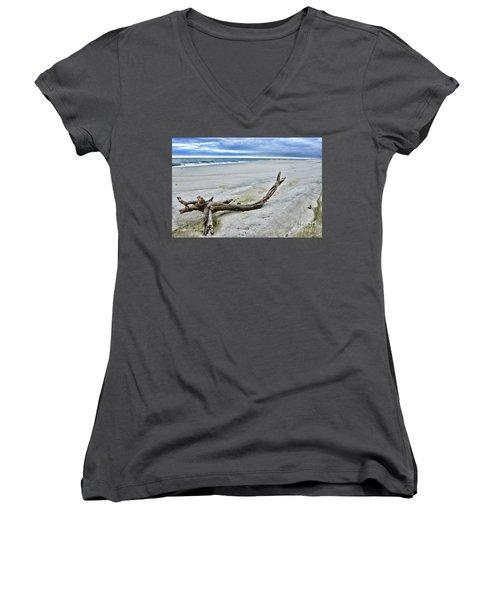 Women's V-Neck T-Shirt (Junior Cut) featuring the photograph Driftwood On The Beach by Paul Ward