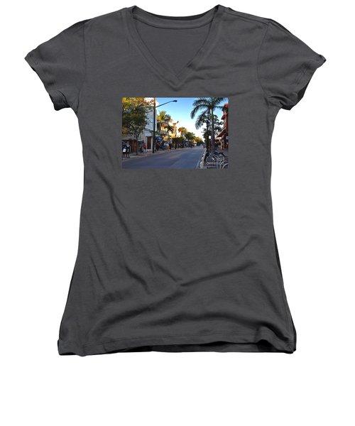 Duval Street In Key West Women's V-Neck T-Shirt (Junior Cut) by Susanne Van Hulst