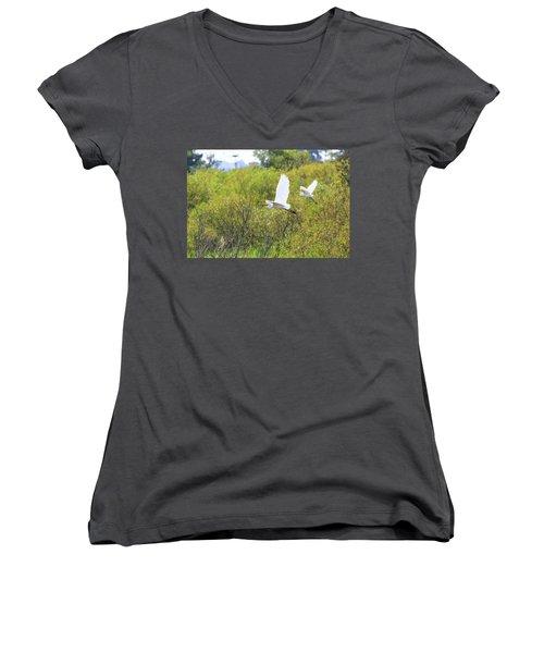 Women's V-Neck T-Shirt (Junior Cut) featuring the photograph Egrets In Flight by Jennifer Casey