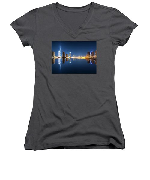 Fascinating Reflection Of Tallest Skyscrapers In Business Bay District During Calm Night. Dubai, United Arab Emirates. Women's V-Neck T-Shirt