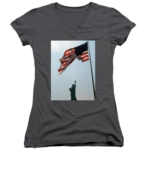 Women's V-Neck T-Shirt (Junior Cut) featuring the photograph Flag And Statue Of Liberty by Carl Purcell