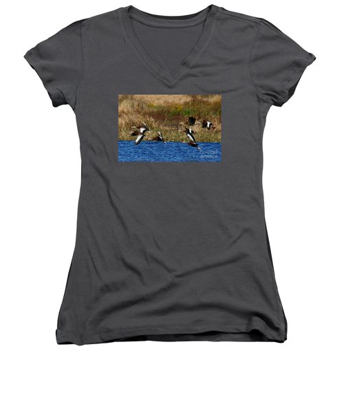 Women's V-Neck T-Shirt (Junior Cut) featuring the photograph Flight Of The Whistlers by Myrna Bradshaw