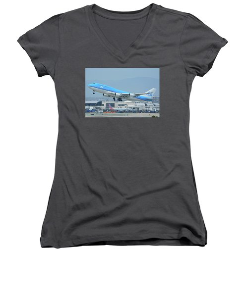 Women's V-Neck T-Shirt (Junior Cut) featuring the photograph Klm Boeing 747-406m Ph-bfh Los Angeles International Airport May 3 2016 by Brian Lockett