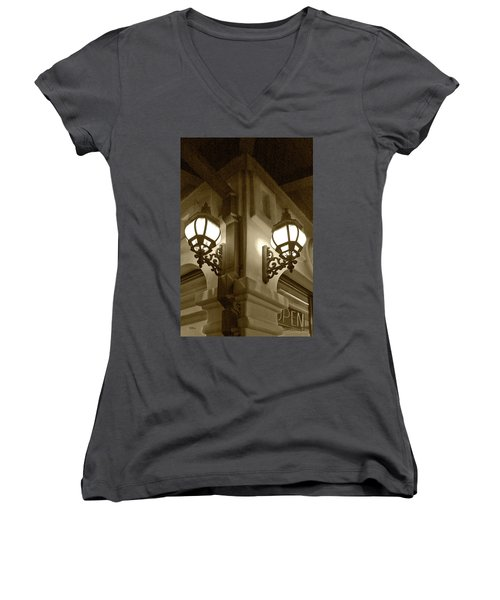 Women's V-Neck T-Shirt (Junior Cut) featuring the photograph Lanterns - Night In The City - In Sepia by Ben and Raisa Gertsberg