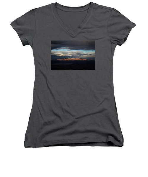 Women's V-Neck T-Shirt (Junior Cut) featuring the photograph Late Light On Red Rocks With Storm Clouds by Ron Chilston