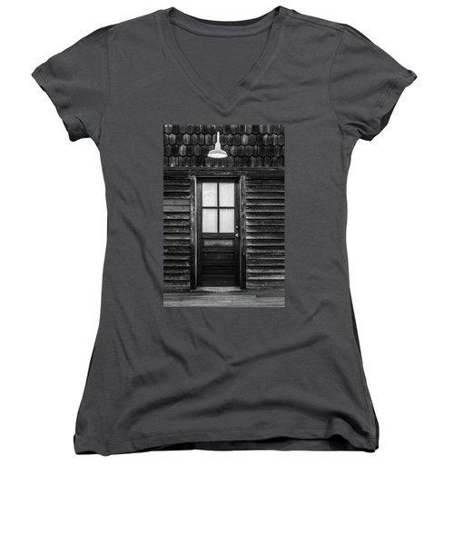 Women's V-Neck T-Shirt (Junior Cut) featuring the photograph Old Wood Door And Light Black And White by Terry DeLuco