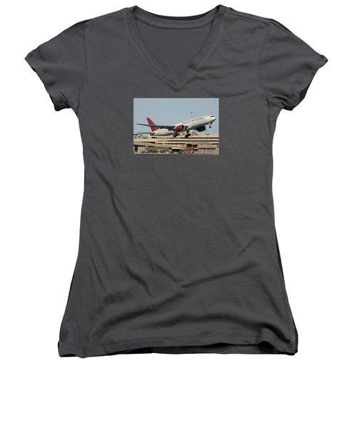 Omni Air International Boeing 777-222 N927ax Phoenix Sky Harbor January 3 2015 Women's V-Neck T-Shirt (Junior Cut) by Brian Lockett