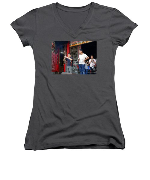 Women's V-Neck T-Shirt (Junior Cut) featuring the photograph Praying At A Temple In Taiwan by Yali Shi