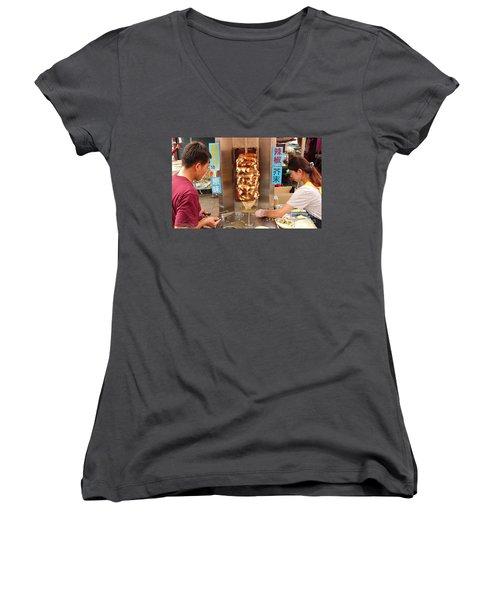 Women's V-Neck T-Shirt (Junior Cut) featuring the photograph Preparing Shawarma Meat In Bread Buns by Yali Shi