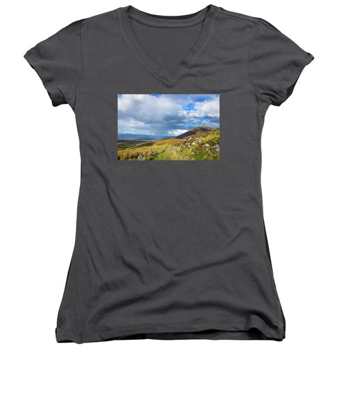 Women's V-Neck T-Shirt (Junior Cut) featuring the photograph Raining Down And Sunshine With Rainbow On The Countryside In Ire by Semmick Photo