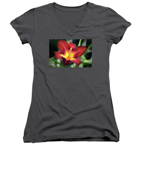 Women's V-Neck T-Shirt (Junior Cut) featuring the photograph Red Volunteer. by Terence Davis