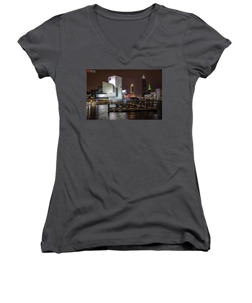 Women's V-Neck T-Shirt (Junior Cut) featuring the photograph Rock Hall Of Fame And Cleveland Skyline by Peter Ciro