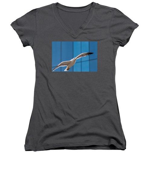 Seabird Flying On The Glass Building Background Women's V-Neck