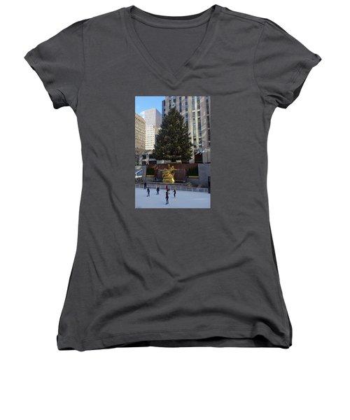 Women's V-Neck T-Shirt (Junior Cut) featuring the photograph Skating At Rockefeller Center by Melinda Saminski
