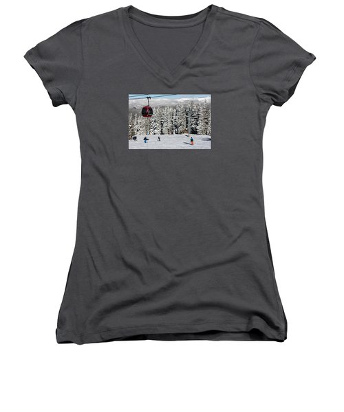 Skiers Limber Up Under A Gondola Near The Summit Of Aspen Mountain Women's V-Neck T-Shirt