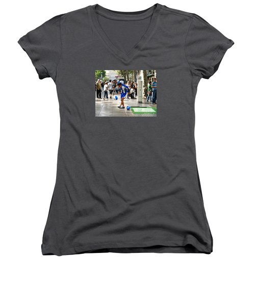 Women's V-Neck T-Shirt (Junior Cut) featuring the photograph Soccer Performance by Haleh Mahbod