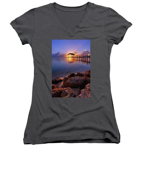 Starburst Sunset Over House Of Refuge Pier In Hutchinson Island At Jensen Beach, Fla Women's V-Neck T-Shirt (Junior Cut) by Justin Kelefas