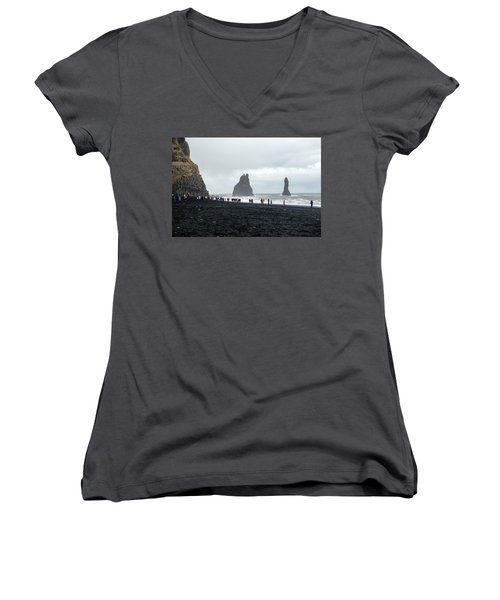 Women's V-Neck T-Shirt featuring the photograph Visitors In Reynisfjara Black Sand Beach, Iceland by Dubi Roman
