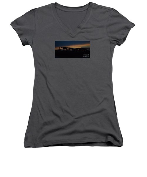 Women's V-Neck T-Shirt (Junior Cut) featuring the photograph Wagon Train Slihoutte by Mark McReynolds