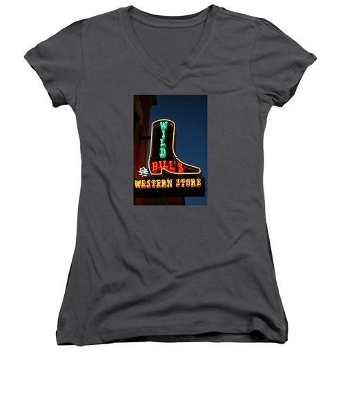 Women's V-Neck T-Shirt (Junior Cut) featuring the photograph Wild Bills Western Store by James Kirkikis