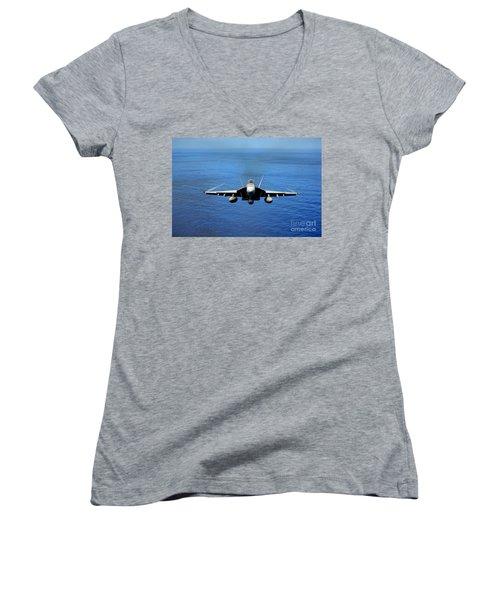 Women's V-Neck T-Shirt (Junior Cut) featuring the photograph  A Fa-18 Hornet Demonstrates Air Power. by Paul Fearn