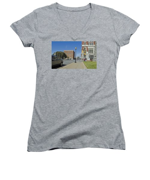 Women's V-Neck T-Shirt (Junior Cut) featuring the photograph Texas School Book Depository by Charles Beeler