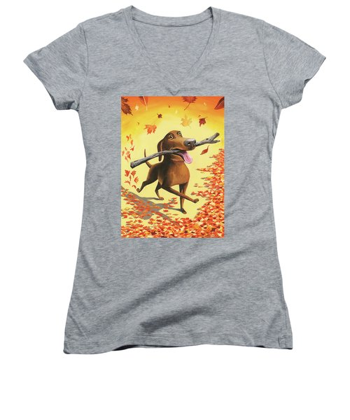 A Dog Carries A Stick Through Fall Leaves Women's V-Neck