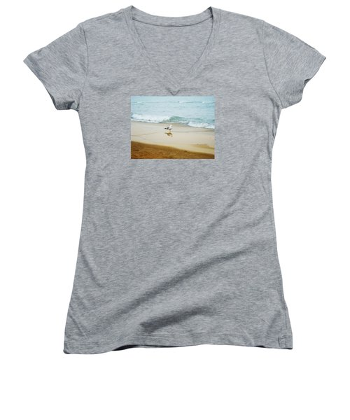 Women's V-Neck T-Shirt (Junior Cut) featuring the photograph Bird On The Beach by Milena Ilieva
