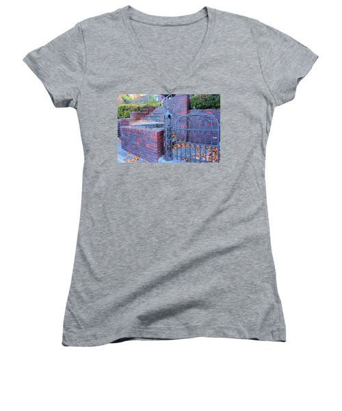 Women's V-Neck T-Shirt (Junior Cut) featuring the photograph Brick Wall With Wrought Iron Gate by Janette Boyd