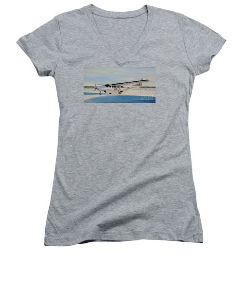 Women's V-Neck T-Shirt (Junior Cut) featuring the painting Cessna 208 Caravan by Marilyn  McNish